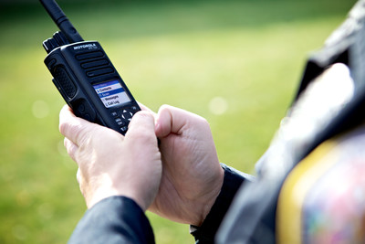 Person holding two-way radio