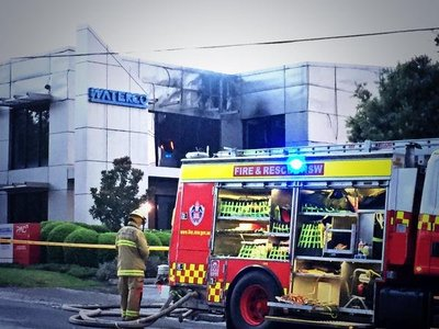 Firefighters extinguish the Waterco blaze. Image courtesy of Nine News.