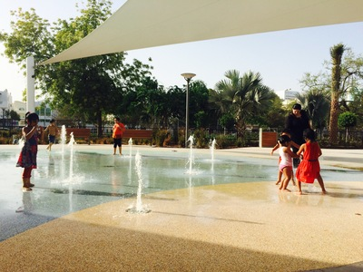 Kids keeping cool in the water play area at Mushrif Central Park.