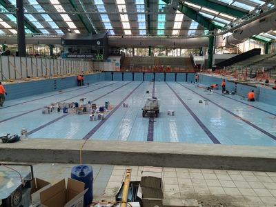 Tiling of the 50 m pool in progress.