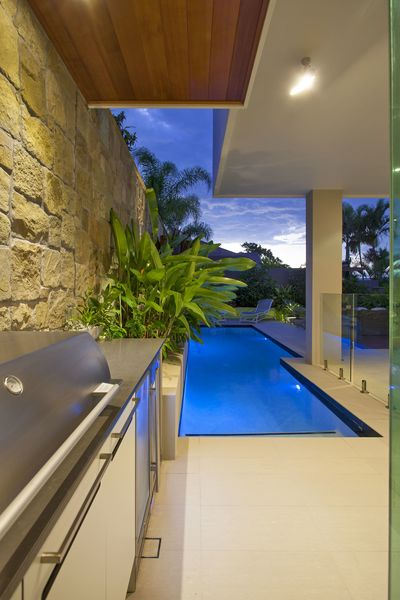 Detail of the outdoor kitchen and planter behind the pool.