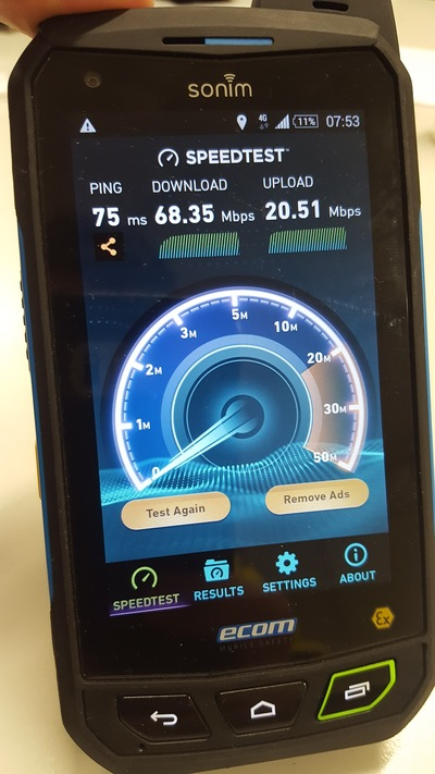 Screenshot of a mobile device showing download and upload speeds