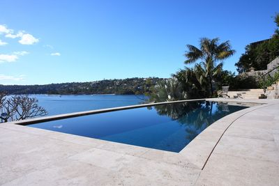 The pool takes in the spectacular views of Middle Harbour.
