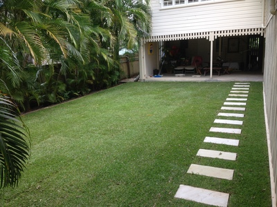 After: the family now has an expanse of lawn.