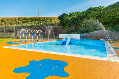 The children's pool has a slide and interactive features. Image courtesy of Waterco.