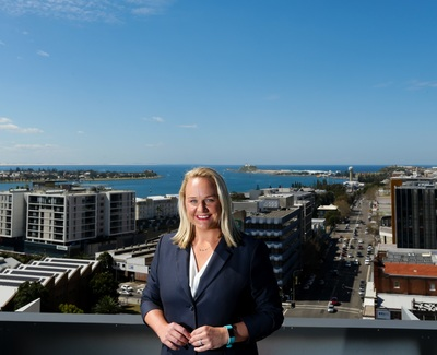 Portrait image of Nuatali Nelmes with Newcastle city and harbour in the background