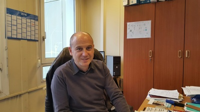 Jean Yves-Concalves sitting at a desk