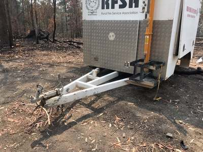 An exterior image of the vandalised radio repeater trailer with its tyres and other equipment missing