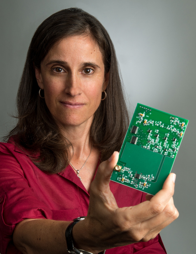 Lisa Mazzuca holding an electronics board